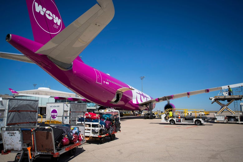 This photograph taken on August 6, 2018, shows a Wow (Icelandic low-cost company) Airbus A321-200 aircraft being loaded with cargo on the tarmac at Roissy-Charles de Gaulle Airport, north of Paris. (Photo by JOEL SAGET / AFP)        (Photo credit should read JOEL SAGET/AFP/Getty Images)