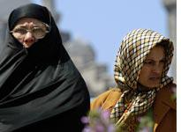 A Turkish woman in a chador beside a woman in a traditional headscarf. Click image to expand.