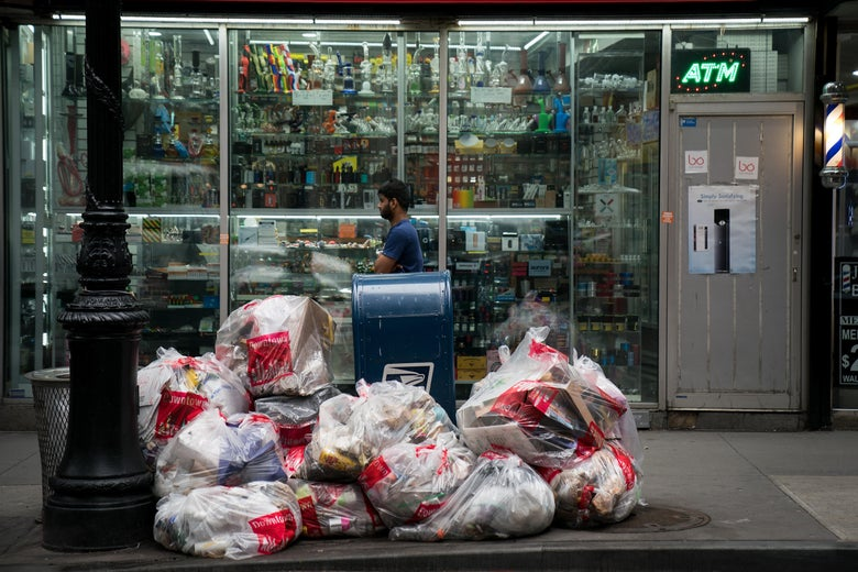 NEW YORK, NY - FEBRUARY 22: A pedestrian walks past bags of trash on a sidewalk in Lower Manhattan, February 22, 2018 in New York City. Using data from Environmental Protection Agency, the American Housing Survey and the U.S. Census Bureau, a new report from the cleaning and janitorial company BusyBee ranks New York City as the dirtiest city in the nation. (Photo by Drew Angerer/Getty Images)