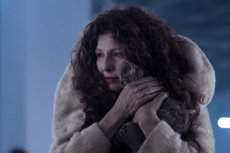 Catherine Keener, wearing a fur coat, holds a kitten to her face.
