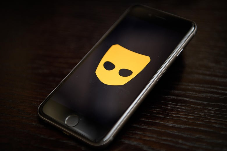The 'Grindr' app logo is seen on a mobile phone screen.