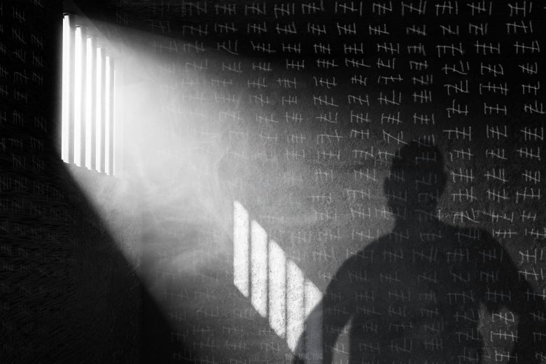 A shadow of a man in a jail cell is projected on a wall where tally marks counting the time have been made.