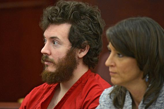 James Holmes, left, and defense attorney Tamara Brady appear in district court in Centennial, Colo. for his arraignment on March 12, 2013.