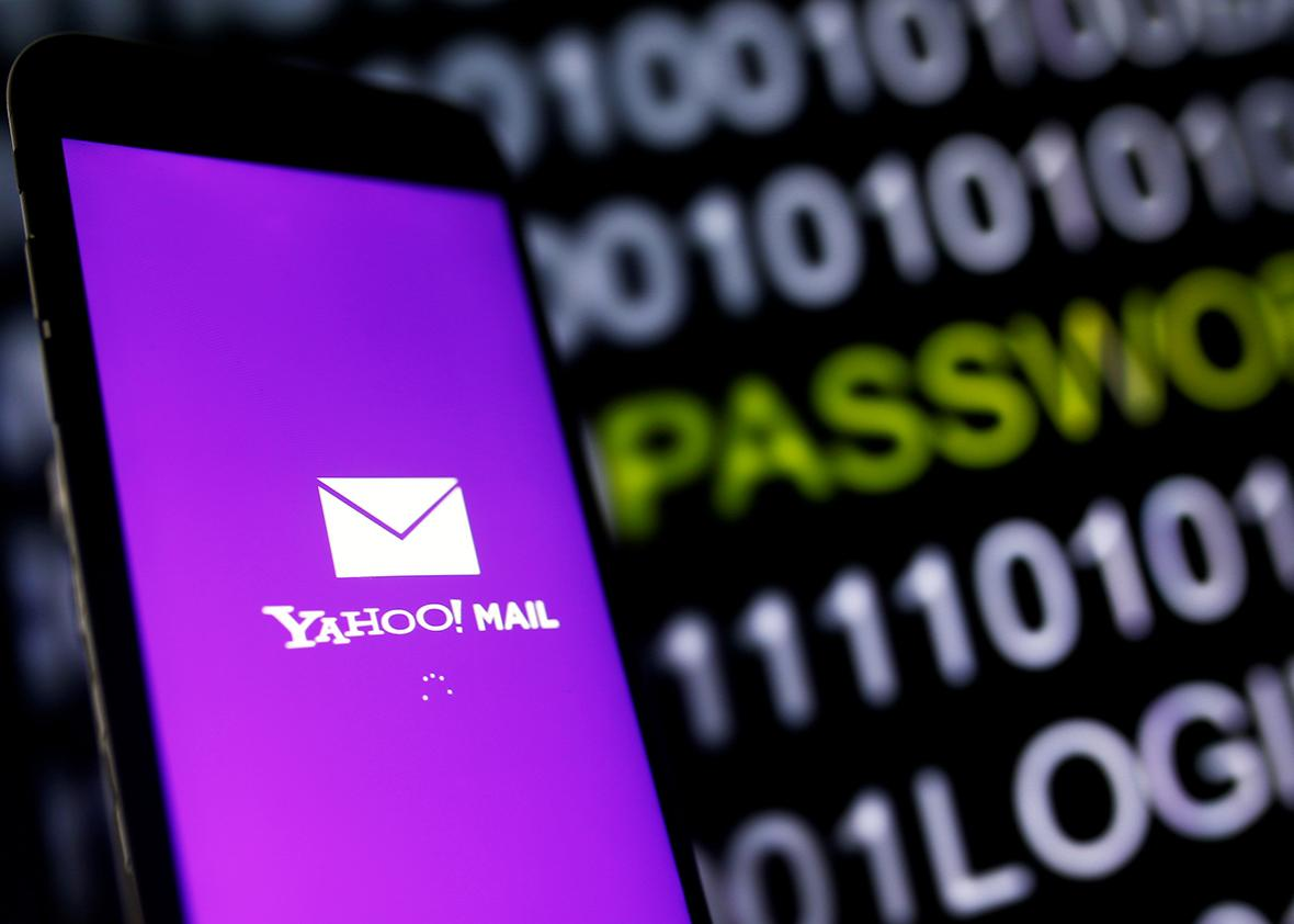 Yahoo Mail logo is displayed on a smartphone's screen in front of a code in this illustration taken in October 6, 2016.