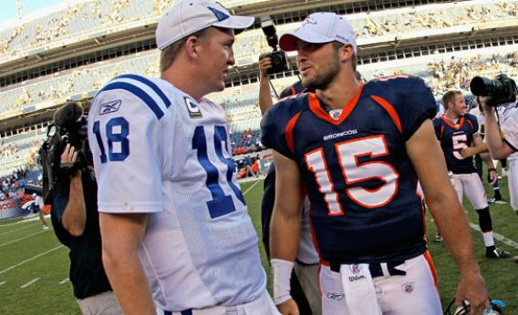 Quarterback Peyton Manning #18 of the Indianapolis Colts and quarterback Tim Tebow #15 of the Denver Broncos meet