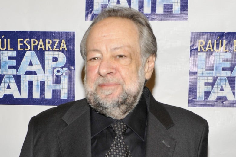Ricky Jay on a red carpet.