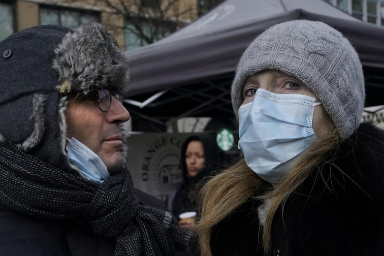 Tourists wearing masks  walk through Union Square in New York City on February 28, 2020, amid fears of the coronavirus and a global pandemic. - The World Health Organization raised its global risk assessment of the new coronavirus to its highest level after the epidemic spread to sub-Saharan Africa and caused financial markets to plunge. (Photo by TIMOTHY A. CLARY / AFP) (Photo by TIMOTHY A. CLARY/AFP via Getty Images)