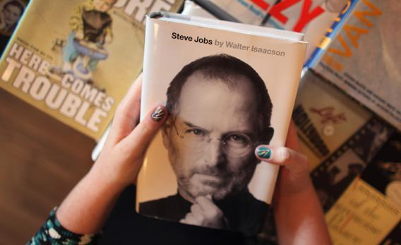 Alison Weiss looks at a copy of the newly released biography of Apple co-founder and former CEO Steve Jobs at the Books & Books store.,130302364JR001_ANTICIPATED_