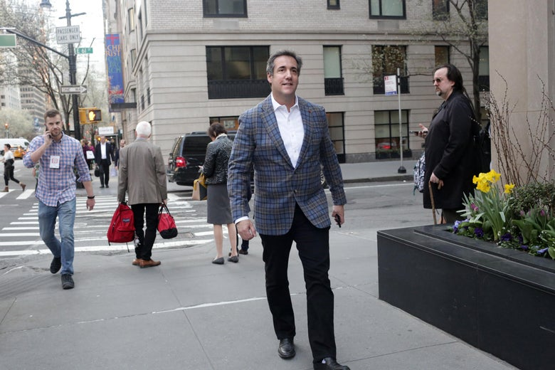 Michael Cohen walks on the New York City sidewalk.