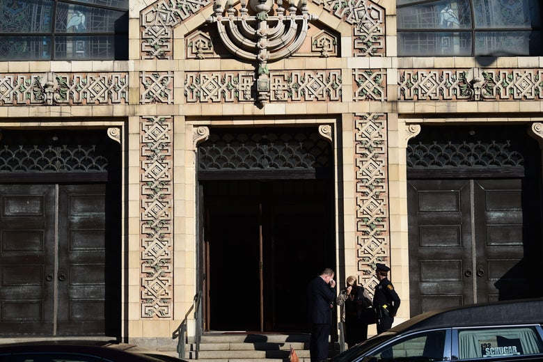 Mourners arrive at a Pittsburgh synagogue for the funeral of two brothers killed in the Tree of Life shooting.