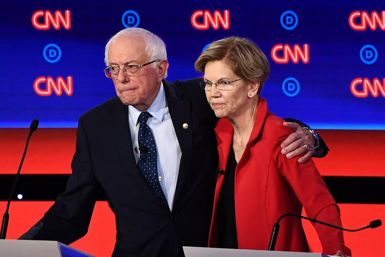 Democratic presidential hopefuls Sen. Bernie Sanders and Sen. Elizabeth Warren hug after participating in the first round of the second Democratic primary debate of the 2020 presidential campaign season in Detroit, Michigan on July 30, 2019.