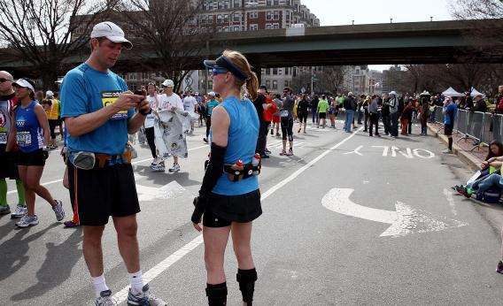 Boston Marathon runner on cell phone