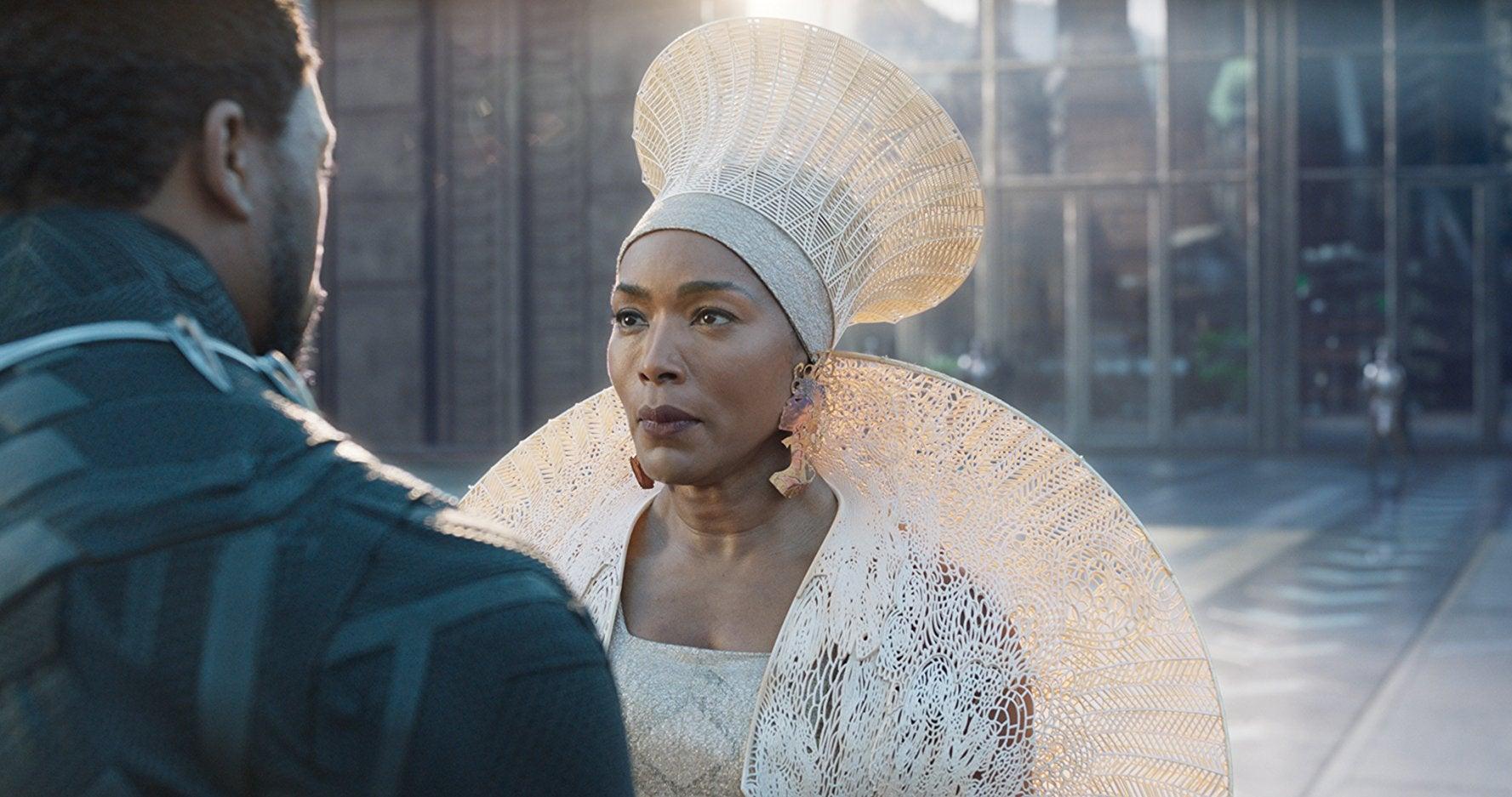 Angela Bassett as Queen Ramonda wears an elaborate white costume with a tall hat.