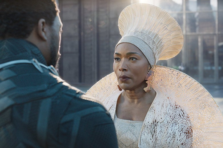 Angela Bassett as Queen Ramonda wears an elaborate white costume with a tall hat.