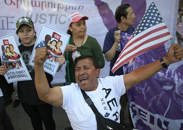A man chants during an immigration rally on May 1, 2014, in Los Angeles.