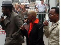 """will.i.am, Angelique Kidjo, and apl.de.ap peform """"In My Name."""" Click image to expand."""