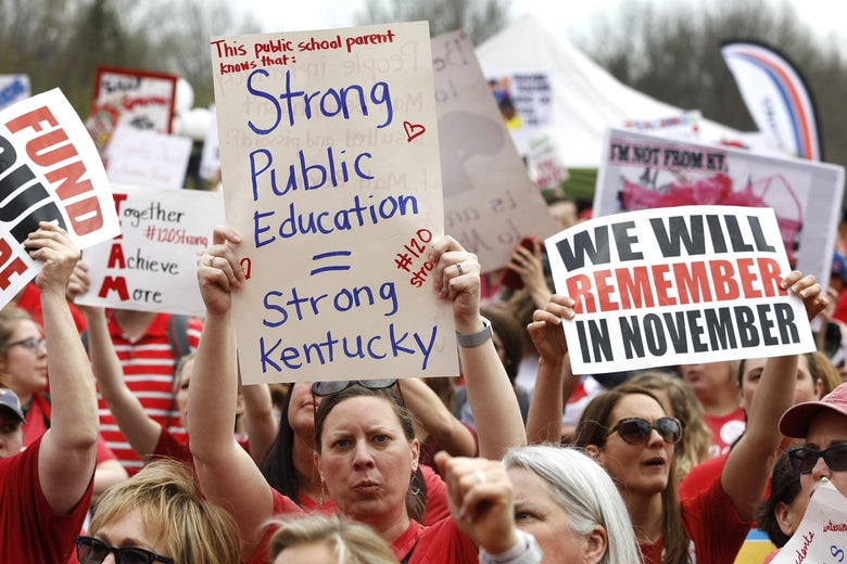 """Kentucky Public school teachers rally for a """"day of action"""" at the Kentucky State Capitol to try to pressure legislators to override Kentucky Governor Matt Bevin's recent veto of the state's tax and budget bills April 13, 2018 in Frankfort, Kentucky."""