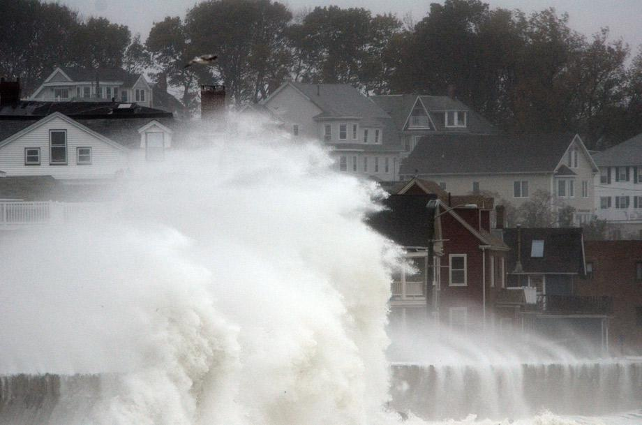 Waves crash over Winthrop Shore Drive as Hurricane Sandy comes up the coast on Monday in Winthrop, Massachusetts.