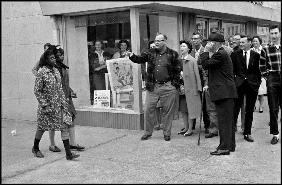 Magnum photographers document progess of blacks, women, and gay rights.