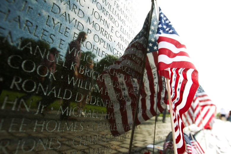 A U.S. flag adorns the wall of the Vietnam Veterans Memorial in Washington on May 28, 2017.