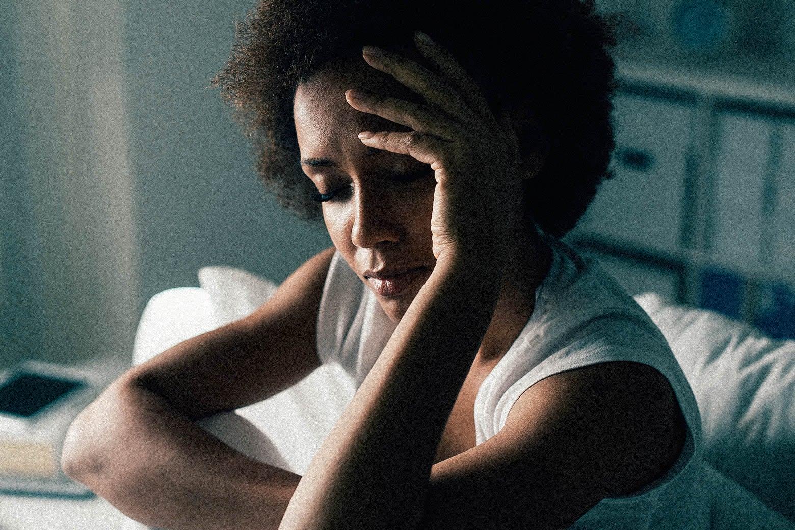 A woman having  trouble sleeping.