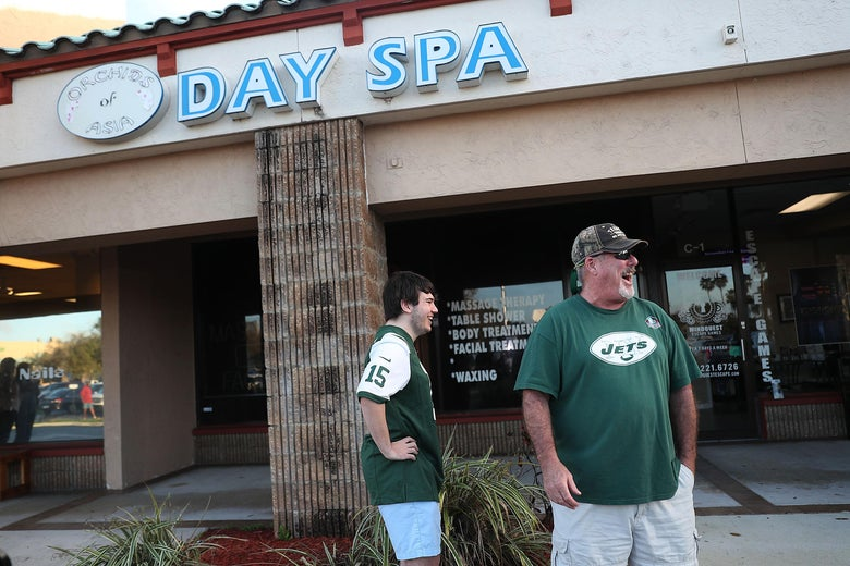 Matthew Gizze (L) and Kevin Brown, both of whom are N.Y. Jet football fans, stop to look at the Orchids of Asia Day Spa where New England Patriots owner Robert Kraft is charged with allegedly soliciting for sex on February 22, 2019 in Jupiter, Florida.