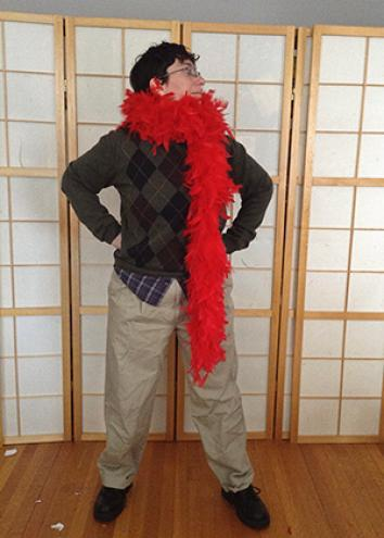 A portrait of the author with a red boa.