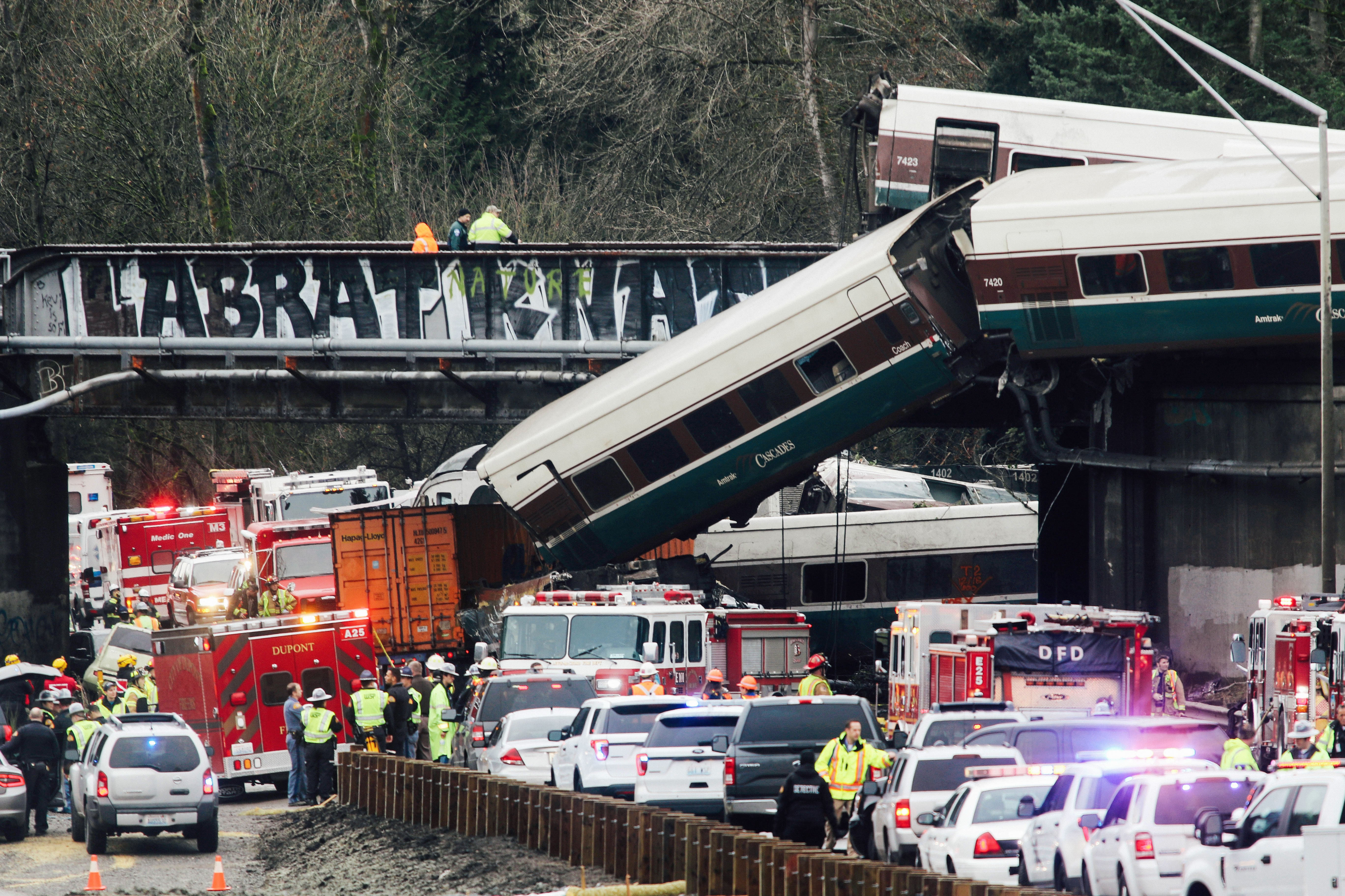 First responders are at the scene of the Amtrak passenger train that derailed and is hanging from a bridge over the Interstate 5 in DuPont, Washington, on Monday.