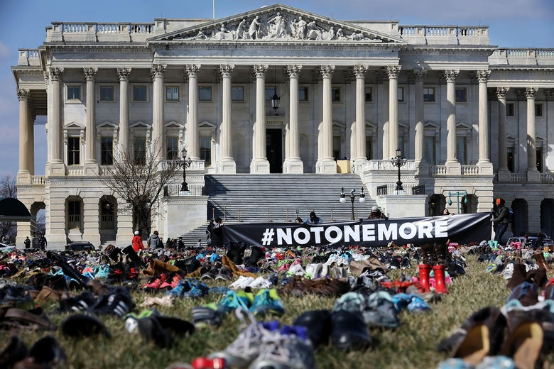 Seven thousand pairs of shoes, representing the children killed by gun violence since the mass shooting at Sandy Hook Elementary School in 2012, are spread out on the lawn on the east side of the U.S. Capitol March 13, 2018 in Washington, DC. Organized by the online activist group Avaaz, the shoes are intended to urge Congress to pass gun-reform legislation.