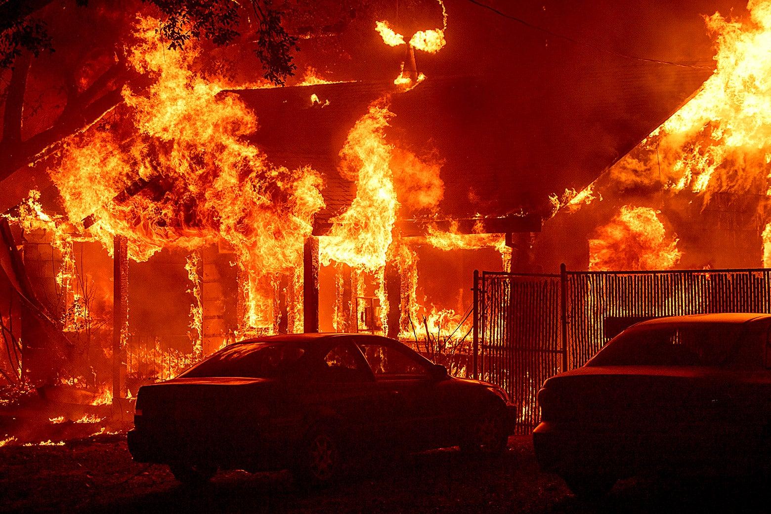 A home burns as the Camp Fire tears through Paradise, California on Nov. 8.