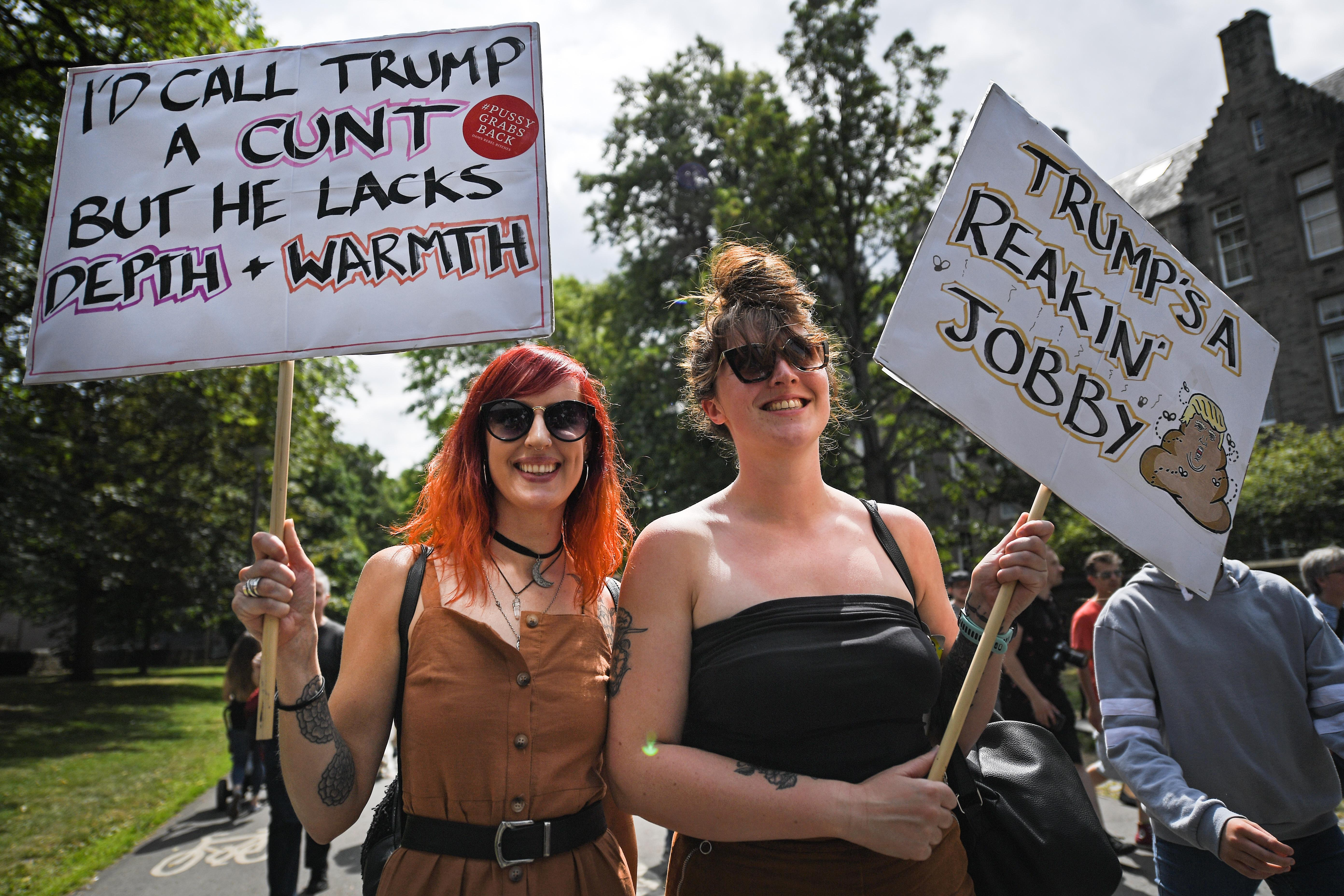 People march holding anti-Trump signs on July 14, 2018 in Edinburgh, Scotland.
