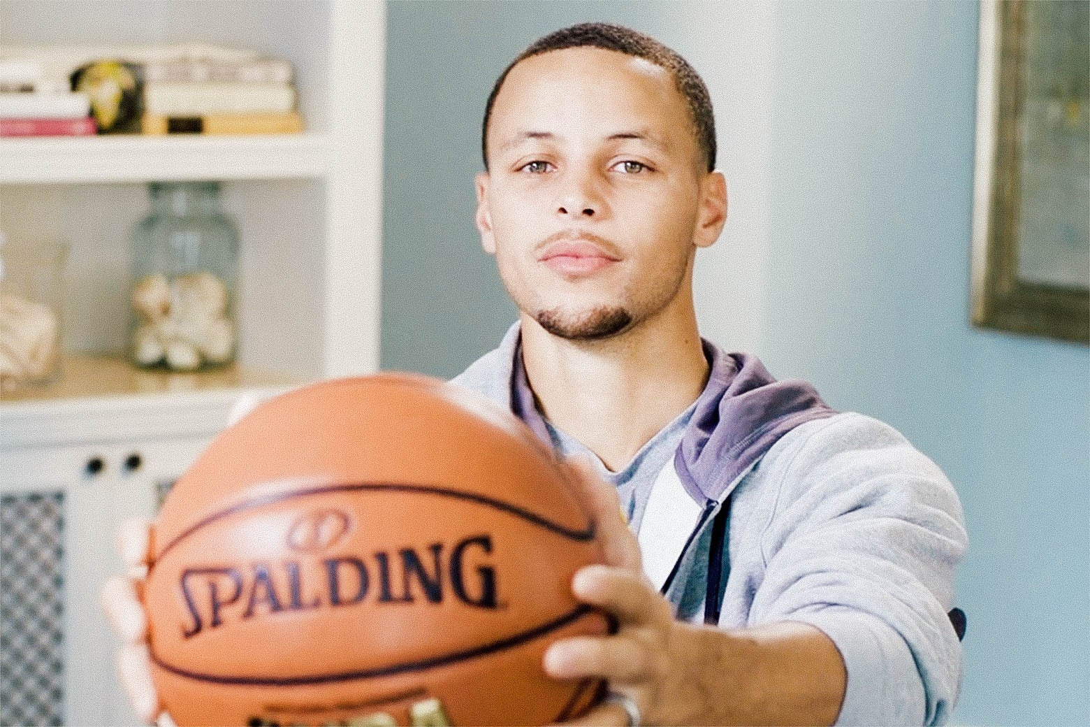 Stephen Curry holding a basketball.