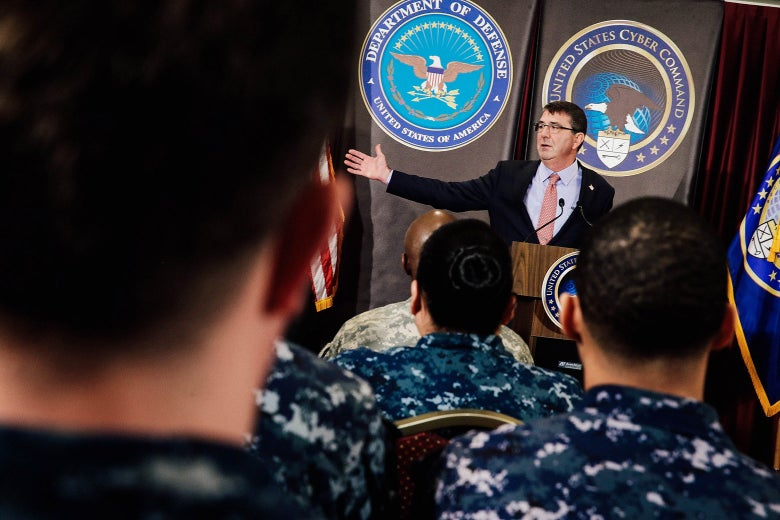 Ash Carter at a podium in front of troops and employees.
