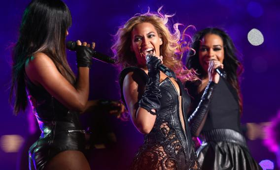 Beyonce lords it over Kelly Rowland and Michelle Williams at the Super Bowl halftime show.