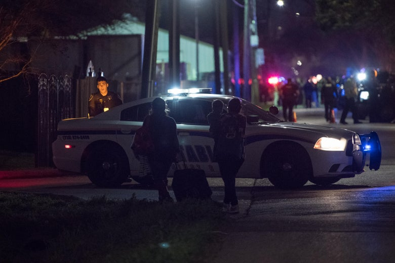 Local residents try to reach their homes near the scene of a shooting where four Houston police officers were reported shot January 28, 2019 in Houston, Texas.