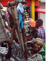 Young men sell a variety of products on the streets of Arusha. Click image to expand.