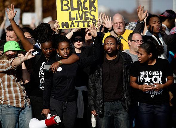 Demonstrators protest the shooting death of Michael Brown.
