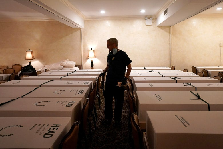 Funeral Director Omar Rodriguez looks over caskets of bodies at the Gerard J. Neufeld funeral home during the outbreak of the coronavirus disease (COVID-19) in Queens, New York on April 26.