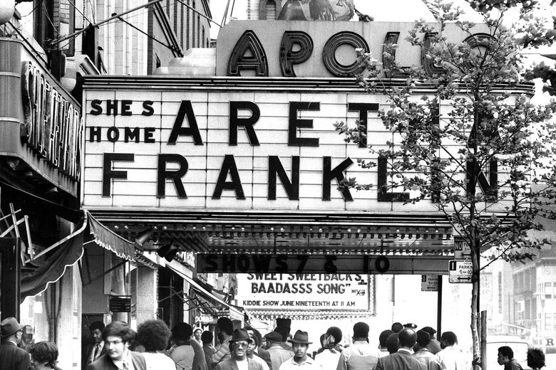 "The Apollo Theater marquee in 1971, reading ""She's Home: Aretha Franklin."""
