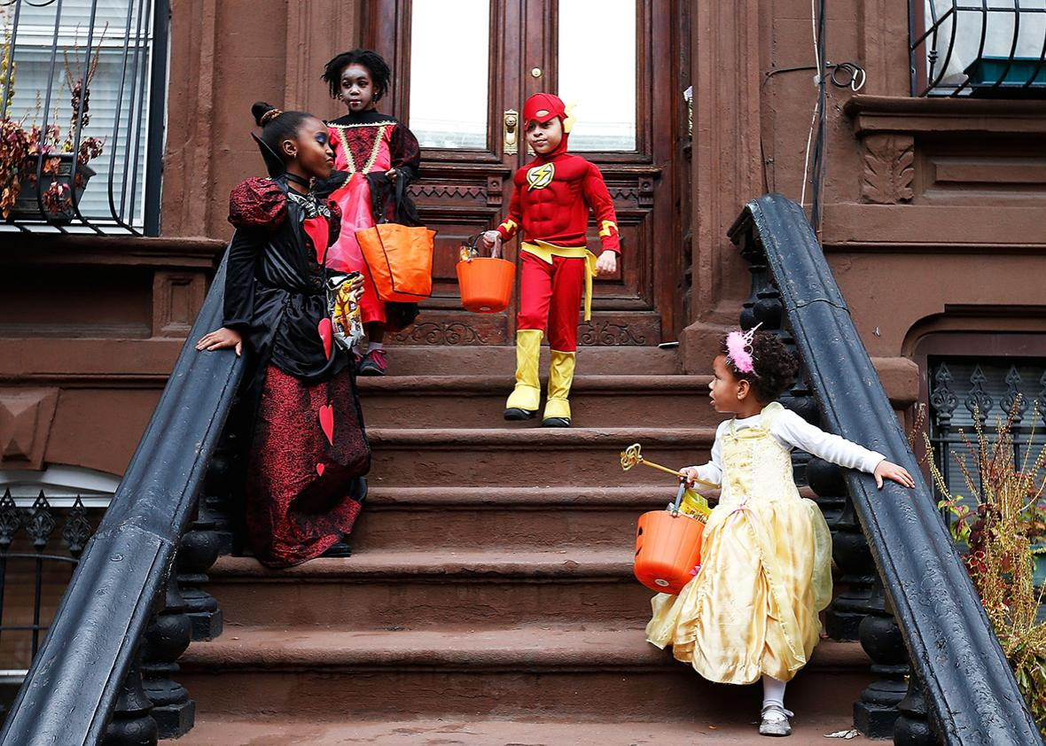 "Children of the Jefferson Village Block Association ""Trick or Treat"" at local residences in Bedford Stuyvesant, Brooklyn on October 31, 2013 in New York City."