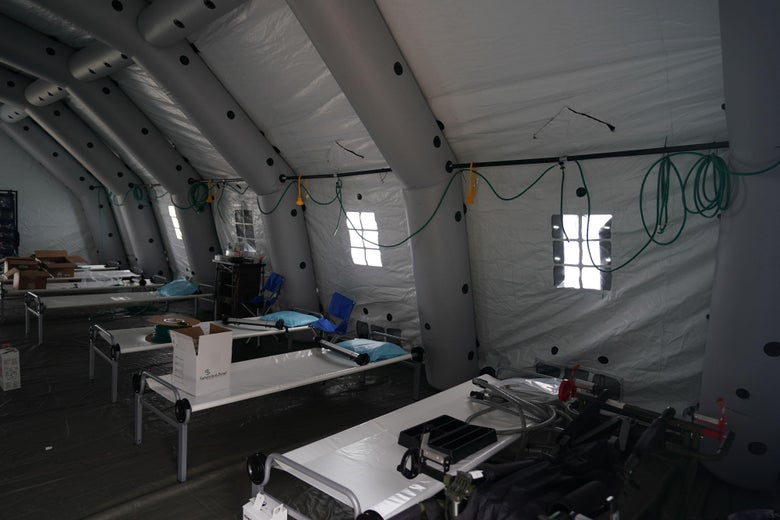 Beds are lined up in a tent as volunteers from the International Christian relief organization Samaritans Purse set up an Emergency Field Hospital for patients suffering from the coronavirus in March 2020.
