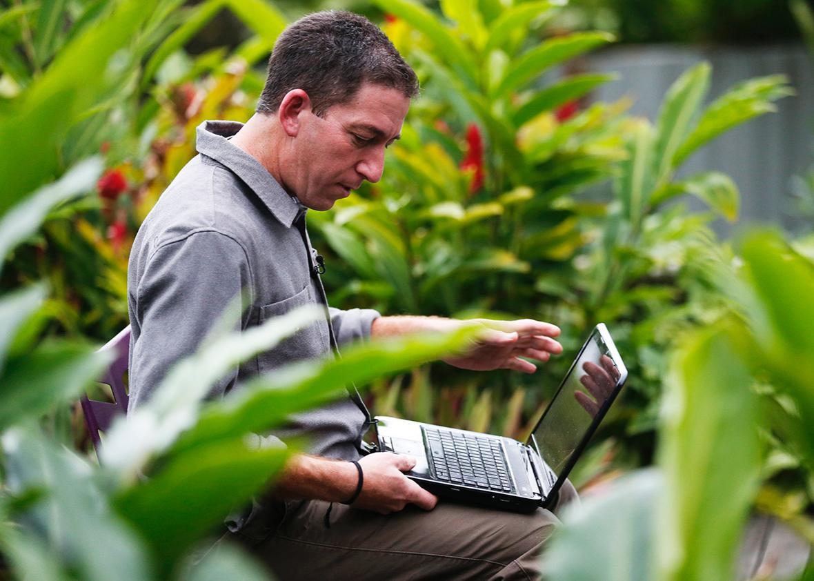 Glenn Greenwald, the blogger and journalist who broke the U.S. National Security Agency surveillance scandal, uses his laptop before an exclusive interview with Reuters in Rio de Janeiro July 9, 2013.