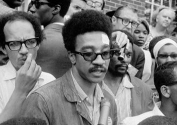 American civil rights activist H. Rap Brown speaks to a crowd of reporters, 1967.