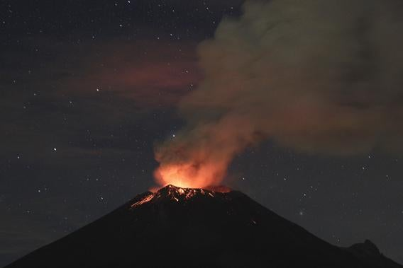 Smoke rises from the Popocatepetl as it spews incandescent volcanic material on the outskirts of Puebla.