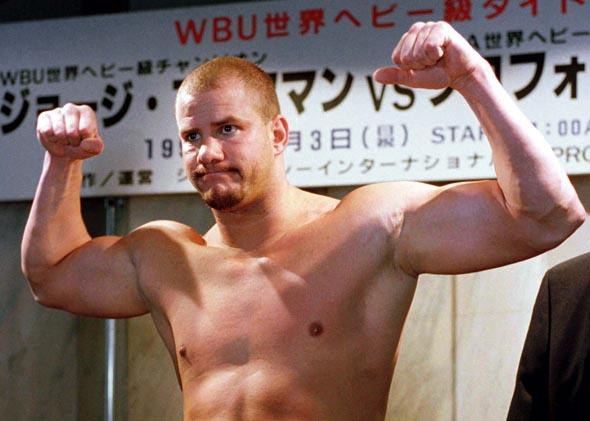 HIV infected heavyweight boxer and former WBO champion Tommy Morrison of the United States poses during a weigh-in in Tokyo November 2, 1996.