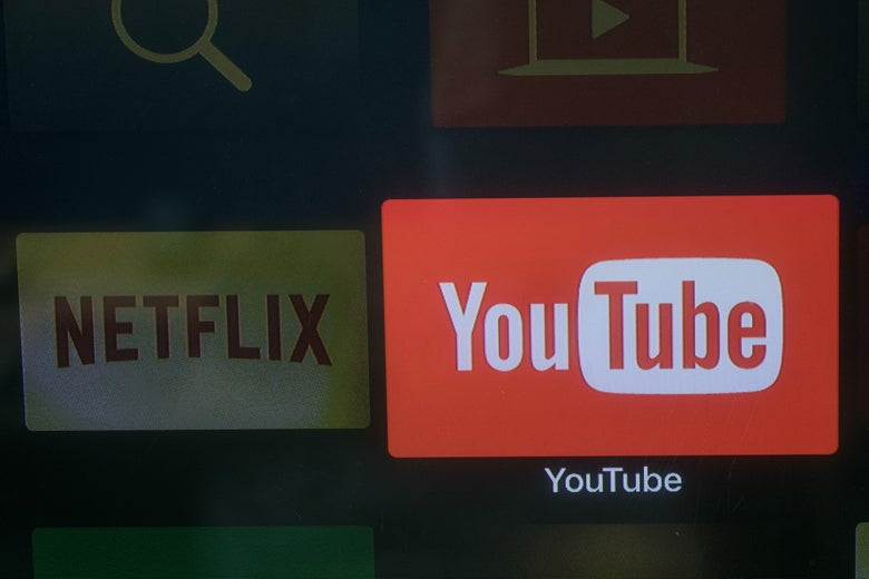 The YouTube and Netflix app logos are seen on a television screen.