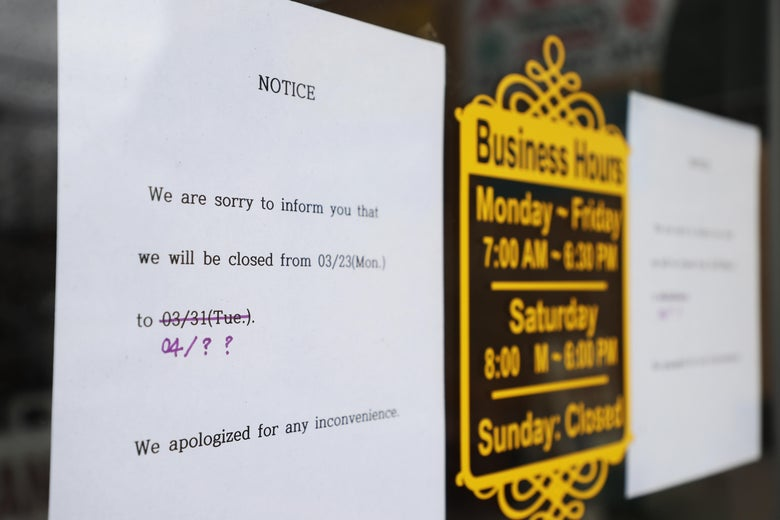 MERRICK, NEW YORK - MARCH 31:  A sign at a dry cleaners notes that the store is closed due to the coronavirus pandemic on March 31, 2020 in Merrick, New York. The World Health Organization declared coronavirus (COVID-19) a global pandemic on March 11.   (Photo by Al Bello/Getty Images)