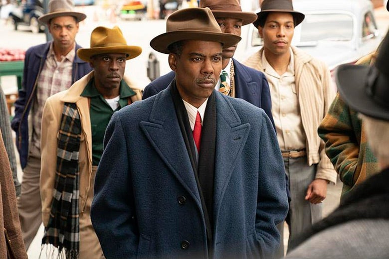 Chris Rock and four other Black men in period dress.