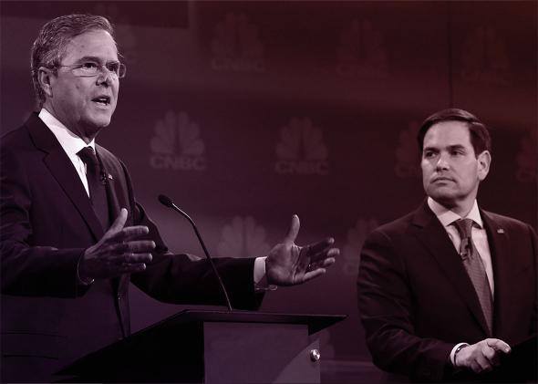Republican Presidential hopeful Jeb Bush (L) speaks as Marco Rubio looks on during the CNBC Republican Presidential Debate, October 28, 2015 at the Coors Event Center at the University of Colorado in Boulder, Colorado.