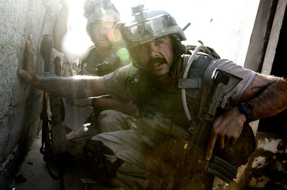 During the massive U.S. attack on the al Qaeda stronghold of Tall Afar, soldiers of the 1st and 3rd U.S. Special Forces Groups, soldiers of the Blue Platoon, Grim Troop, Sabre Squadron, 3rd Armored Cavalry Regiment, and Iraqi special forces of the 36th Commando Brigade and soldiers of the 2nd Iraqi Army Division search for insurgents in Tall Afar, Ninawa governorate, Iraq on Sept. 4, 2005. On days two and three of the attack, the soldiers cleared Shiite Turkoman civilians from their homes in the city's south. Their homes line what U.S. planners dubbed 'Route Corvette'. Soon, combat engulfed the forces' northern advance towards 'Route Barracuda', the gateway to the al Qaeda stronghold in the Sarai district, as insurgents engaged them with sniper fire and RPGs from rooftops and windows along the ancient winding laneways. Civilians not yet cleared were caught in the crossfire, rushing past the battling soldiers even as insurgents were taken prisoner in the midst of the fight.
